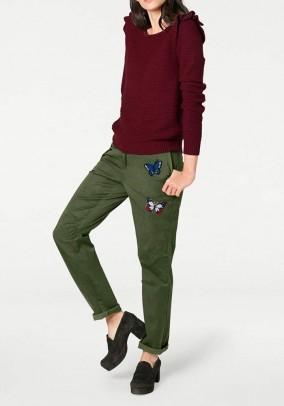 Žalios dekoruotos kelnės