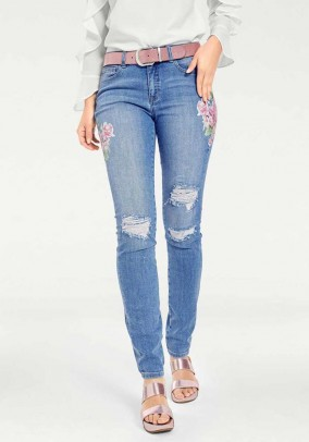 Šviesiai mėlyni dekoruoti džinsai