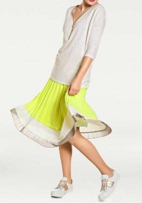 Geltonas klostuotas sijonas