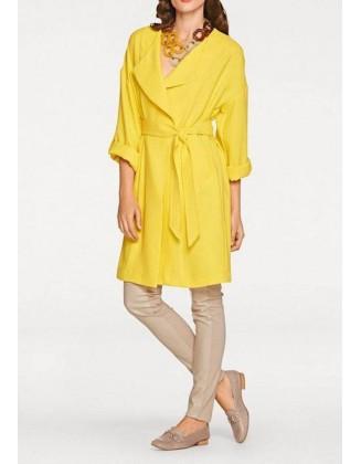 Ryškiai geltonas paltukas