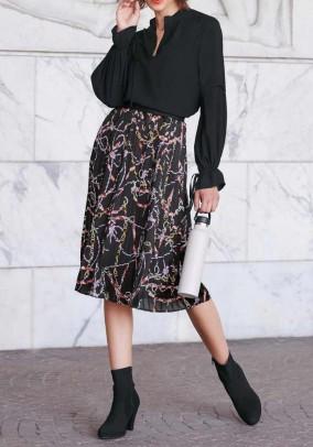 Margas klostuotas sijonas