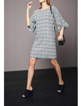Laisvos stiliaus taškuota suknelė